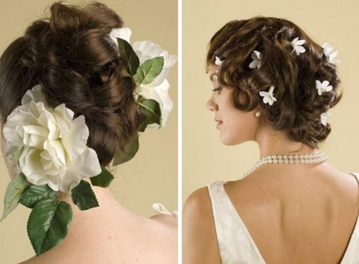 Large white flowers with green leafs & Many small, white flowers accent brides hairstyle