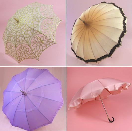 Bridal parasols in cream lace; colorful umbrellas in lavender, pink and cream with black trim