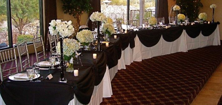 Head table will line up wedding party on either side of bride and groom