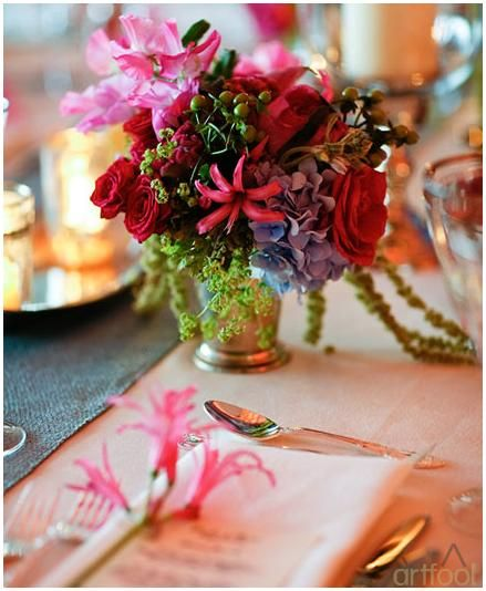 Beautiful low table centerpiece with funky, vibrant flowers