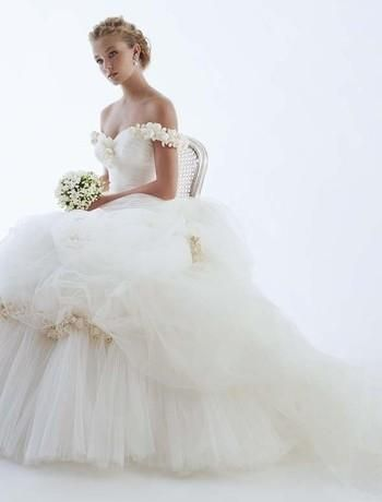 Romantic and whimsical RS Couture off-the-shoulder wedding dress, full, tiered, tulle skirt