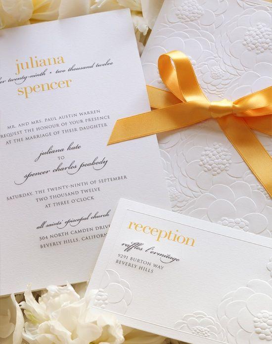 White wedding invitation with orange ribbon and orange and black writing, designed by Vera WANG.