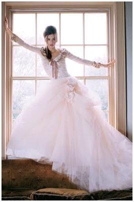 Light pink wedding dress using yards of lightweight pink tulle