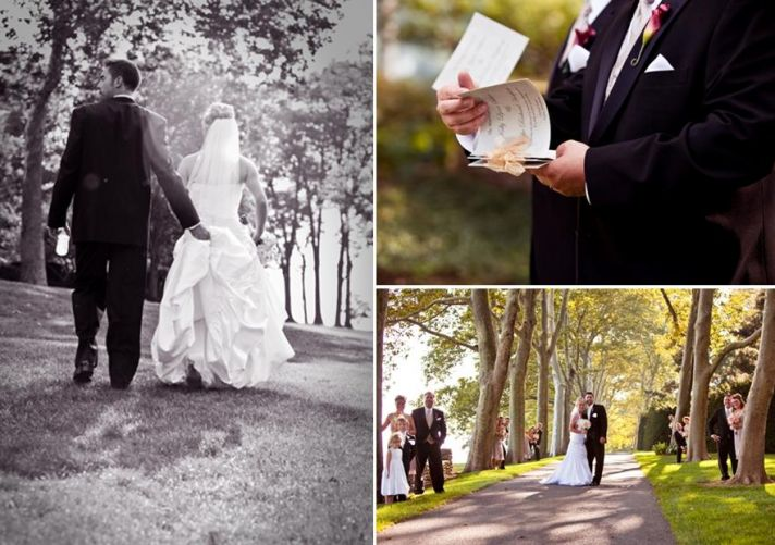 Groom hold back of brides white wedding dress as they walk through the forest together