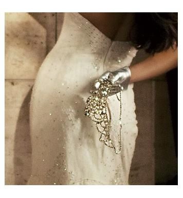 Sassy short silver metallic gloves worn with a white strapless wedding dress
