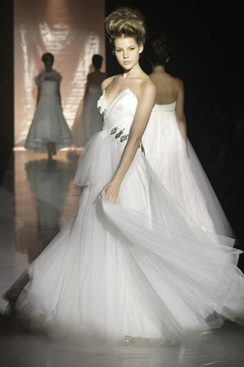 Stunning white strapless wedding dress with a full tulle skirt and jeweled