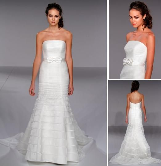 Strapless wedding dress with bow at natural waist, and tiered mermaid skirt