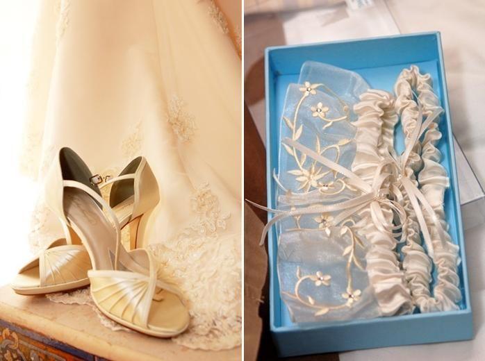 Wedding detail shots: ivory peep toe bridal heels, and cream garter sitting in something blue box