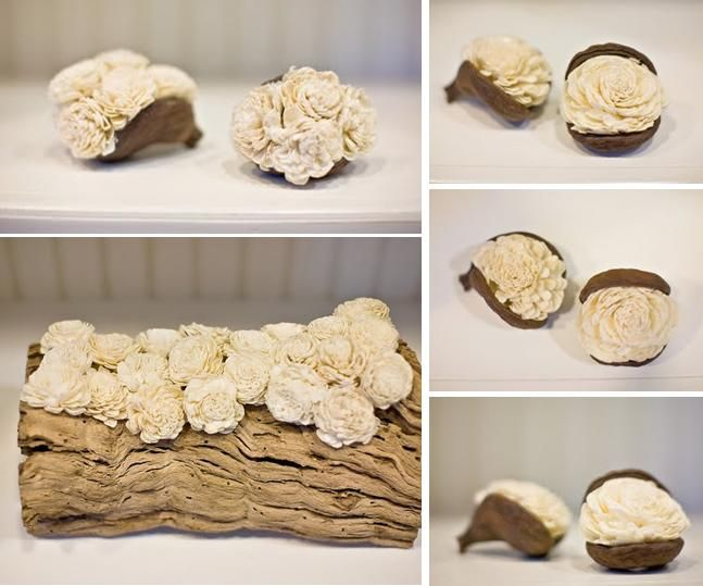 Gorgeous ivory balsa wood flowers arranged on natural grapewood branch and badam pods