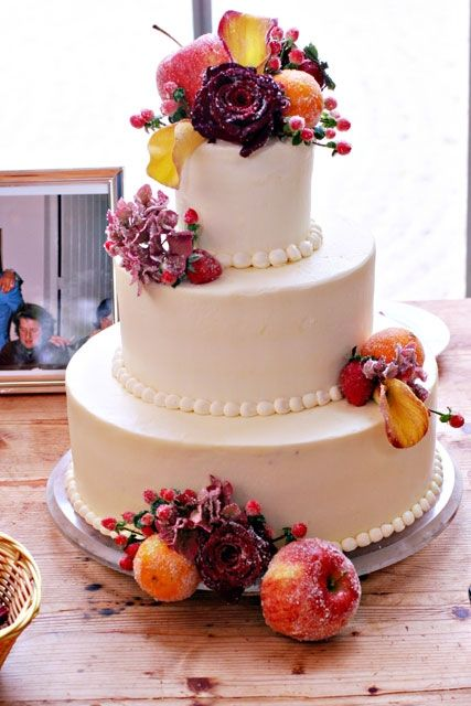 Beautiful three-tier round white wedding cake- organic and delicious!