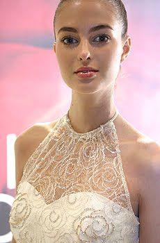 Wedding dress with white sweetheart neckline corset underneath sheer beaded halter