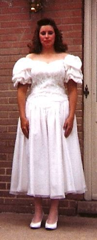 This woman looks decidedly unhappy in her poofy wedding dress.
