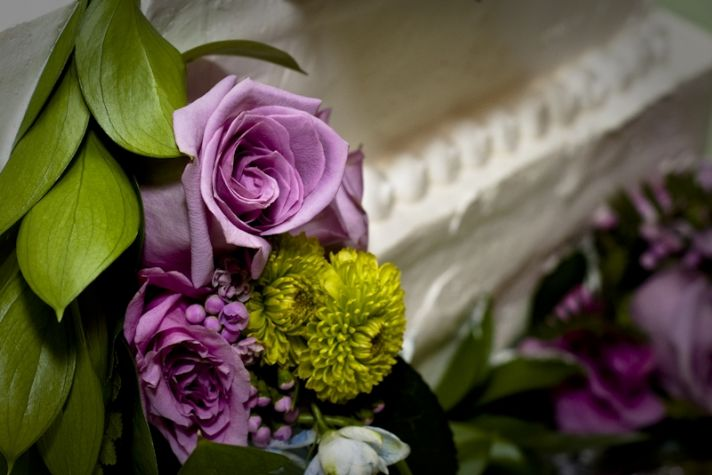 Gorgeous detail shot of lavender, lilac, and green floral arrangements