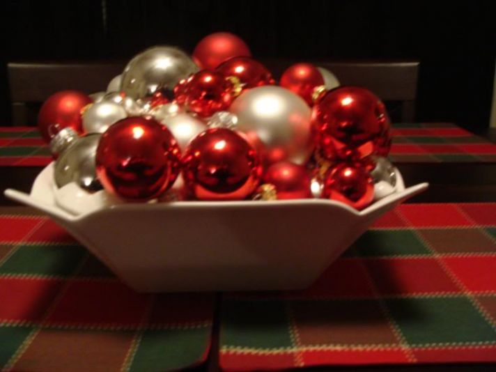 These red, white, and silver ornaments create a Christmas themed centerpiece perfect for a holiday w