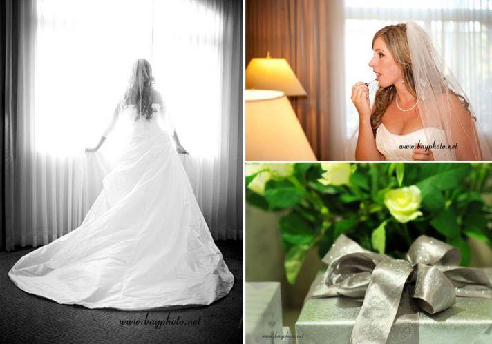 Artistic wedding photo- bride wears gorgeous wedding dress, stands in window