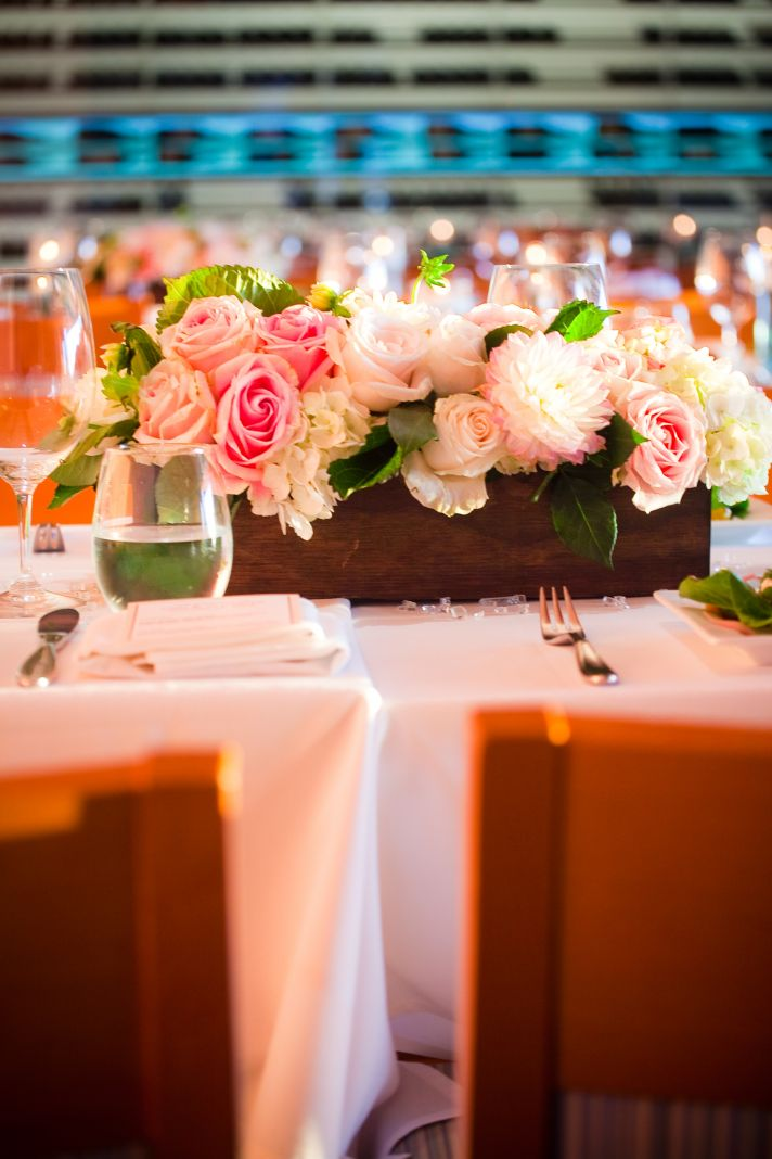 Stunning pink, beach, and green tablescape at this casual yet luxurious San Diego wedding