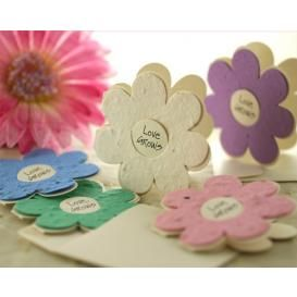 These purple, pink, white, green, and blue paper daisies are made out of paper that is filled with s