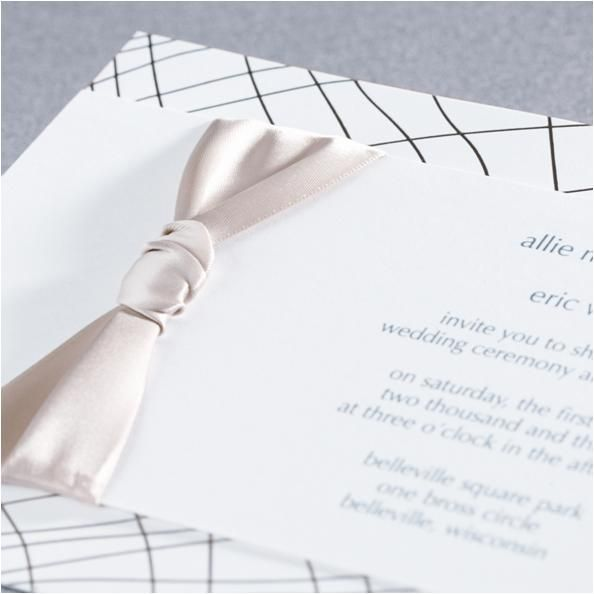 Monique Lhuillier luxurious wedding invitations with gold foil design and champagne ribbon