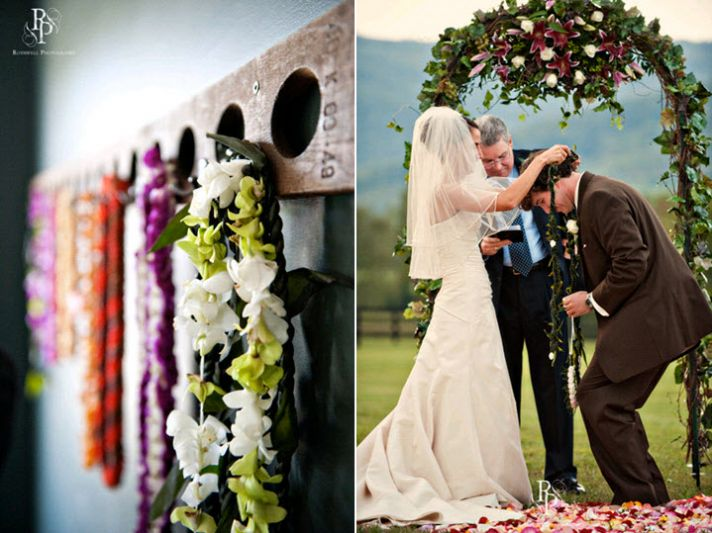 Vibrant red, purple and green leis hang on wall; bride slips lei around grooms neck after saying I D
