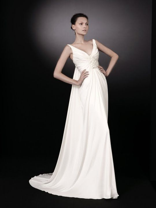 Beautiful white v-neck wedding dress with gathered floral applique at bust