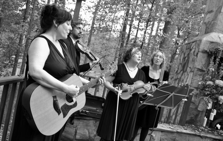 These wedding musicians know their cues at this rustic chic outdoor wedding.