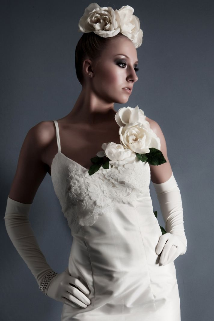 Sheath style ivory wedding dress with touches of lace and floral bridal headpiece