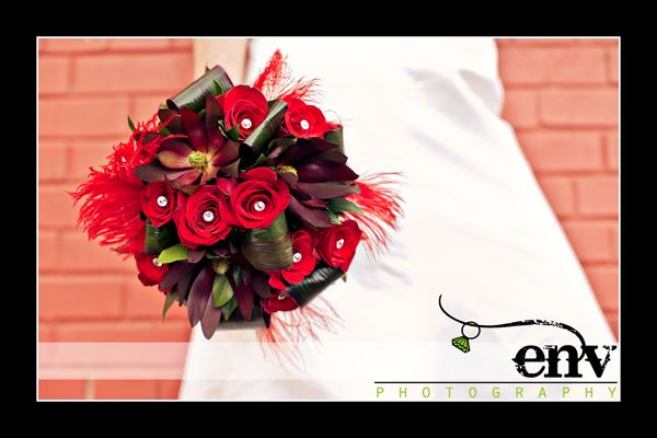 Stunning statement bridal bouquet deep red roses and flowers feathers and