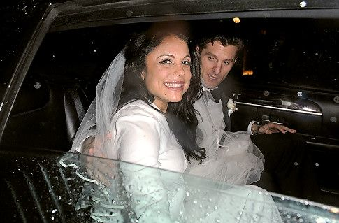 Bethenny Frankel, in custom Amsale wedding dress, sits happily with groom