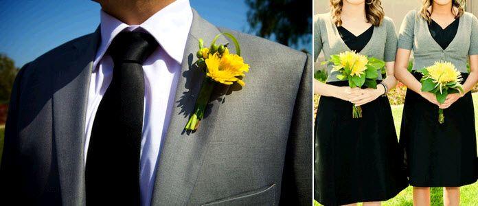 Groom wears grey suit, black tie and yellow boutonniere; bridesmaids wear black dresses, grey sweate