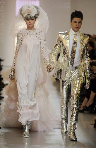 This couple is clearly meant for each other. The fashionable groom wears a gold lame suit and the ha