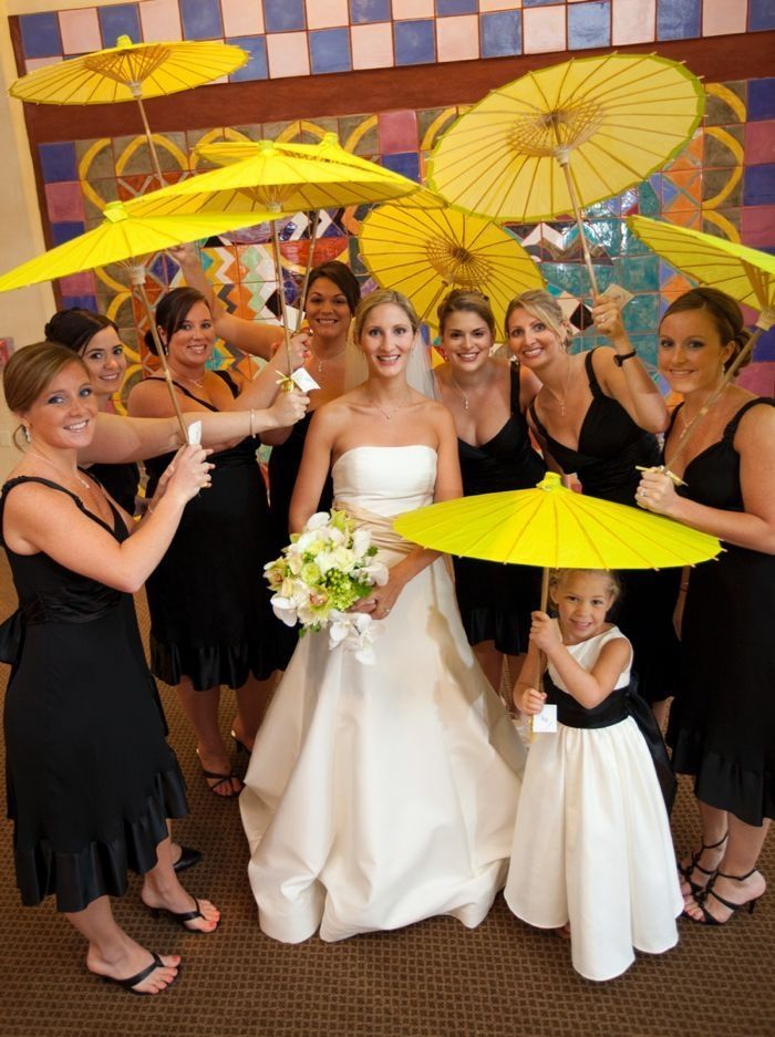 Colorful yellow parasols are the perfect solution for rain (or intense sun) on your wedding day!
