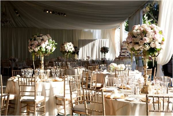 Stunning romantic wedding reception tent with golds ivories