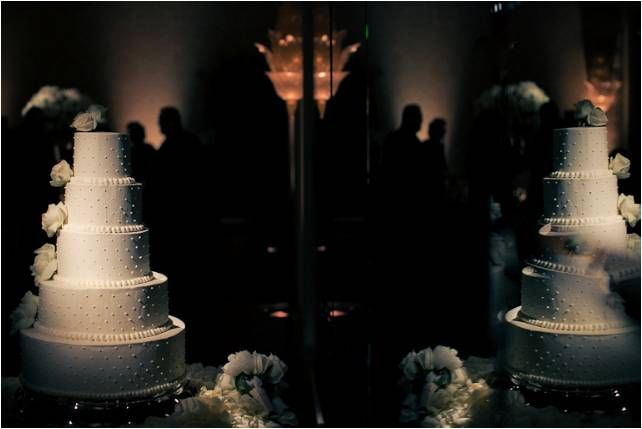Artistic wedding photo- regal 5-tier wedding cake with reflection in mirror