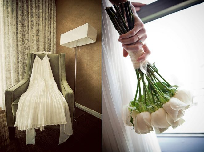 Bride's ivory sheath style wedding dress hangs in hotel room; bride clutching all ivory roses bridal