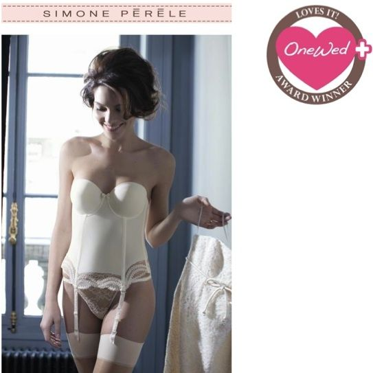 This beautiful brunette bride is wearing gorgeous wedding day lingerie as she gets ready for her wed