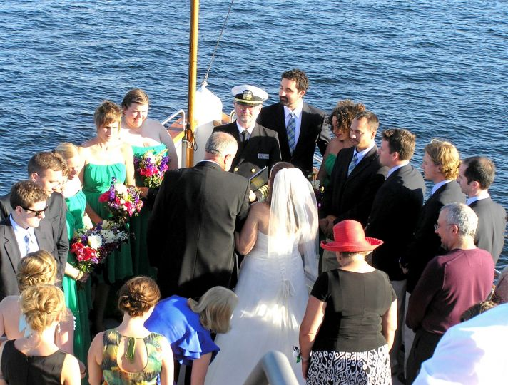 This informal wedding takes place on the bow of a ship.