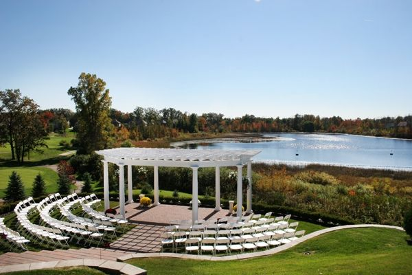 A stunning outdoor wedding venue- a golf course or country club by the lake