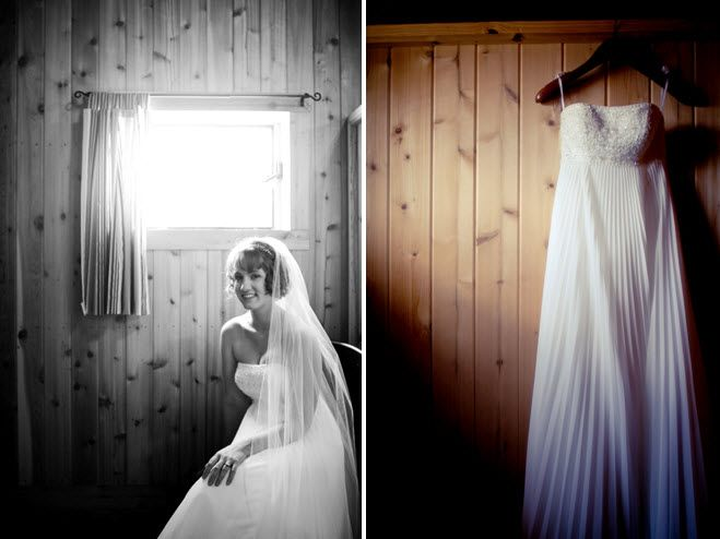 Bride's strapless ivory sheath style wedding dress hangs with light shining through