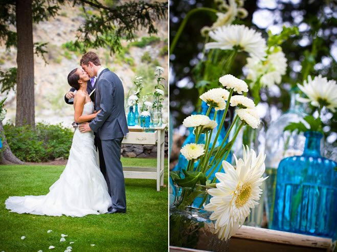 Bride and groom kiss after saying I Do; white, green, aqua wedding reception centerpieces