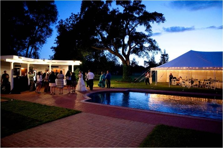 Stunning view of wedding reception tent at winery venue during sunset