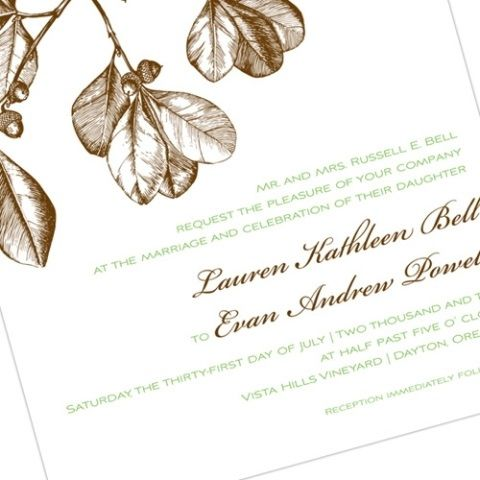 This brown and white wedding invitation features a natural theme with acorns.