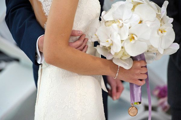 Stunning all white orchid bridal bouquet for Today Show wedding bride