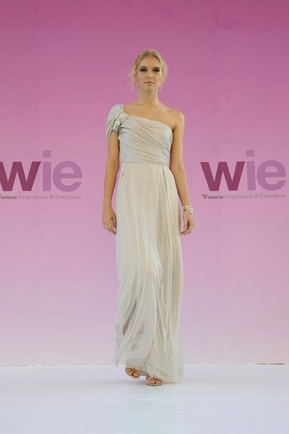 This one-shouldered Grecian style wedding dress is designed by Stella McCartney
