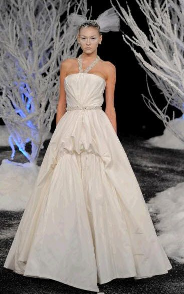 Ivory ballgown wedding dress with jeweled halter, by Douglas Hannant