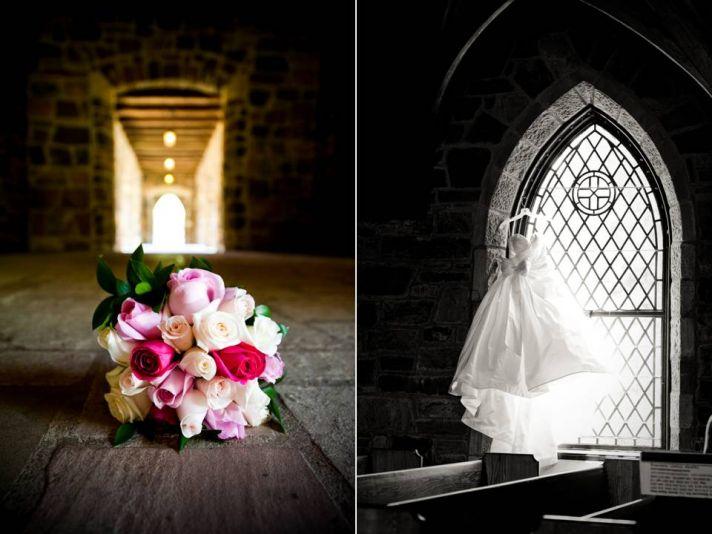 Ivory, pink bridal bouquet lays on venue floor; wedding dress hangs in window