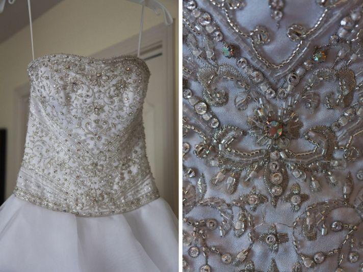 Ivory strapless beaded wedding dress with ruffle-adorned skirt