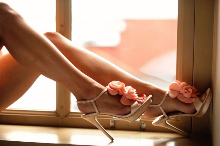 Bride-to-be wears wedding day heels during boudoir shoot