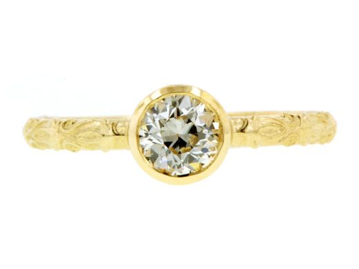Simple hammered gold engagement ring with round diamond center stone