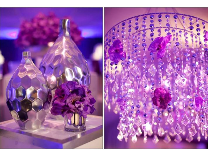 Purple wedding reception decor with chandeliers and purple orchids