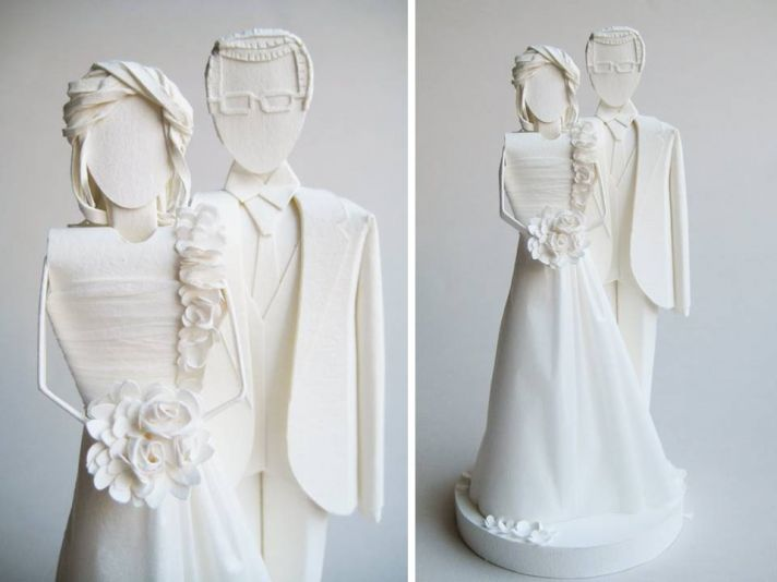All-white handmade wedding cake topper of bride and groom